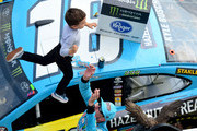 Kyle Busch, driver of the #18 M&M's Hazelnut Toyota, celebrates with his son, Brexton, in Victory Lane after winning the Monster Energy NASCAR Cup Series Pocono 400 at Pocono Raceway on June 02, 2019 in Long Pond, Pennsylvania.