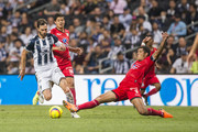 Jose Maria Basanta of Monterrey fights for the ball with Francisco Rodriguez of Lobos during the 16th round match between Monterrey and Lobos BUAP as part of the Torneo Clausura 2018 Liga MX at BBVA Bancomer Stadium on April 21, 2018 in Monterrey, Mexico.