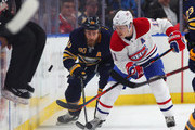Ryan O'Reilly #90 of the Buffalo Sabres and Brendan Gallagher #11 of the Montreal Canadiens go after a puck on the boards during the first period at KeyBank Center on March 23, 2018 in Buffalo, New York.