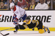 Andrei Markov #79 of the Montreal Canadiens and Daniel Paille #20 of the Boston Bruins battle for the puck during the second period during Game Five of the Second Round of the 2014 NHL Stanley Cup Playoffs at the TD Garden on May 10, 2014 in Boston, Massachusetts.