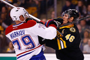 David Krejci #46 of the Boston Bruins shoves Andrei Markov #79 of the Montreal Canadiens in the first period during the game at TD Garden on March 24, 2014 in Boston, Massachusetts.