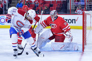 David Desharnais #51 of the Montreal Canadiens moves the puck against Cam Ward #30 of the Carolina Hurricanes during the game at PNC Arena on November 18, 2016 in Raleigh, North Carolina.