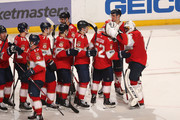 Teammates line up to congratulate Goaltender Roberto Luongo #1 of the Florida Panthers on his shutout win against the Montreal Canadiens at the BB&T Center on March 8, 2018 in Sunrise, Florida. The Panthers defeated the Canadiens 5-0.