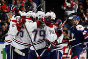 Andrei Markov #79 of the Montreal Canadiens celebrates with teammates after scoring a second period goal against the New York Islanders at Nassau Veterans Memorial Coliseum on December 23, 2014 in Uniondale, New York. This was Markov's 800th game.