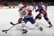 Andrei Markov #79 of the Montreal Canadiens moves the puck away from Johnny Boychuk #55 of the New York Islanders during the second period at the Nassau Veterans Memorial Coliseum on March 14, 2015 in Uniondale, New York.