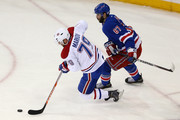 Andrei Markov #79 of the Montreal Canadiens plays the puck against Benoit Pouliot #67 of the New York Rangers during Game Six of the Eastern Conference Final in the 2014 NHL Stanley Cup Playoffs at Madison Square Garden on May 29, 2014 in New York City.