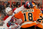 Andrei Markov #79 of the Montreal Canadiens and R.J. Umberger #18 of the Philadelphia Flyers shove each other in the second period on October 11, 2014 at the Wells Fargo Center in Philadelphia, Pennsylvania.