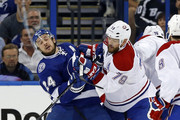 Andrei Markov #79 of the Montreal Canadiens cross checks Ryan Callahan #24 of the Tampa Bay Lightning in Game Four of the Eastern Conference Semifinals during the 2015 NHL Stanley Cup Playoffs at Amalie Arena on May 7, 2015 in Tampa, Florida.