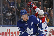 Tyler Bozak #42 of the Toronto Maple Leafs skates away with the puck from Alex Galchenyuk #27 of the Montreal Canadiens during an NHL game at the Air Canada Centre on March 17, 2018 in Toronto, Ontario, Canada. The Maple Leafs defeated the Canadiens 4-0.