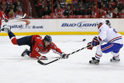 Joey Crabb #15 of the Washington Capitals and Brian Gionta #21 of the Montreal Canadiens go after the puck during the first period at Verizon Center on January 24, 2013 in Washington, DC.