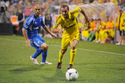 Federico Higuain #33 of the Columbus Crew takes control of the ball and pulls away from Marco Di Vaio #9 of the Montreal Impact in the first half on September 1, 2012 at Crew Stadium in Columbus, Ohio.