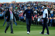 Webb Simpson (C) and Bubba Watson (R) of the United States are spoken to by referee John Paramor on the 1st green during the Morning Fourballs of the 2014 Ryder Cup on the PGA Centenary course at the Gleneagles Hotel on September 26, 2014 in Auchterarder, Scotland.