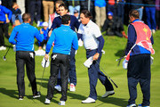 Phil Mickelson and Keegan Bradley of the United States shake hands with Rory McIlroy and Sergio Garcia of Europe on the 18th green after the Morning Fourballs of the 2014 Ryder Cup on the PGA Centenary course at the Gleneagles Hotel on September 26, 2014 in Auchterarder, Scotland.