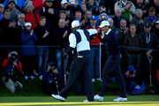 Phil Mickelson (L) and Keegan Bradley of the United States celebrate on the 1st green during the Morning Fourballs of the 2014 Ryder Cup on the PGA Centenary course at the Gleneagles Hotel on September 26, 2014 in Auchterarder, Scotland.