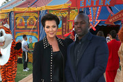 Kris Jenner (L) and Corey Gamble attend Moschino Spring/Summer 19 Menswear and Women's Resort Collection at the Los Angeles Equestrian Center on June 8, 2018 in Burbank, California.