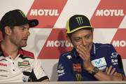 Valentino Rossi of Italy and Movistar Yamaha MotoGP speaks with Cal Crutchlow (L) of Great Britain and LCR Honda during the press conference during the MotoGP Netherlands - Previews on June 28, 2018 in Assen, Netherlands.
