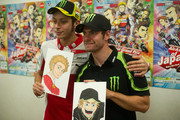 "Valentino Rossi of Italy and Ducati Marlboro Team and Cal Crutchlow of Great Britain and Monster Yamaha Tech 3 (R) during the pre-event ""MotoGP riders meet the manga artist Ranka"" at Twin Ring Hotel at Twin Ring Motegi on October 11, 2012 in Motegi, Japan."