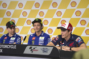 (L-R) Jorge Lorenzo of Italy and Movistar Yamaha MotoGP, Valentino Rossi of Italy and Movistar Yamaha MotoGP and Marc Marquez of Spain and Repsol Honda Team look on during the press conference ahead of the MotoGP of Malaysia at Sepang Circuit on October 22, 2015 in Kuala Lumpur, Malaysia.