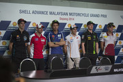 (L-R) Alex Marquez of Spain and Estrella Galicia 0,0, Cal Crutchlow of Great Britain and Ducati team, Valentino Rossi of Italy and Movistar Yamaha MotoGP, Marc Marquez of Spain and Repsol Honda Team, Bradley Smith of Great Britain and Monster Yamaha Tech 3 and Esteve Rabat of Spain and Marc VDS Racing Team pose during the press conference pre-event during the MotoGP Of Malaysia - Preview at Sepang Circuit on October 23, 2014 in Kuala Lumpur, Malaysia.