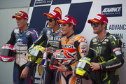 (L-R)   Aleix Espargaro of Spain and Power Electronics Aspar ,  Valentino Rossi of Italy and Yamaha Factory Racing, Marc Marquez of Spain and Repsol Honda Team and Cal Crutchlow of Great Britain and Monster Yamaha Tech 3 pose  at the end of the MotoGP Of Malaysia - Qualifying at Sepang Circuit on October 12, 2013 in Kuala Lumpur, Malaysia.