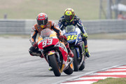 Marc Marquez of Spain and Repsol Honda Team leads Valentino Rossi of Italy and Movistar Yamaha MotoGP during the MotoGP race during the MotoGP Of Malaysia at Sepang Circuit on October 25, 2015 in Kuala Lumpur, Malaysia.