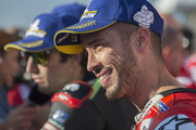 Andrea Dovizioso of Italy and Ducati Team speaks with journalists and celebrates the MotoGP pole position at the end of the qualifying practice during the MotoGP of Japan - Qualifying at Twin Ring Motegi on October 20, 2018 in Motegi, Japan.