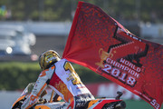 Marc Marquez of Spain and Repsol Honda Team celebrates with flag the MotoGP victory and becoming the 2018 MotoGP champion at the end of the MotoGP race during the MotoGP of Japan - Race at Twin Ring Motegi on October 21, 2018 in Motegi, Japan.
