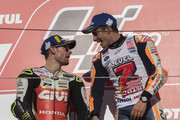 Marc Marquez of Spain and Repsol Honda Team celebrates the MotoGP victory and becoming the 2018 MotoGP champion at the end of the MotoGP race on the podium with Cal Crutchlow of Great Britain and LCR Honda  (L) during the MotoGP of Japan - Race at Twin Ring Motegi on October 21, 2018 in Motegi, Japan.