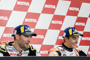 Marc Marquez of Spain and Repsol Honda Team celebrates the MotoGP victory and becoming the 2018 MotoGP champion with Cal Crutchlow of Great Britain and LCR Honda  (L) during the press conference at the end of the MotoGP race during the MotoGP of Japan - Race at Twin Ring Motegi on October 21, 2018 in Motegi, Japan.