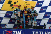 L-R Nico Terol of Spain and Bancaja Aspar Team, Marc Marquez of Spain and Red Bull AJo Motorsport and Pol Espargaro of Spain and Tuenti Racing pose on the podium  at the end of the 125 cc race of Grand Prix of Netherlands in TT Assen Circuit on June 26, 2010 in Assen, Netherlands.