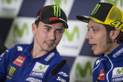 Jorge Lorenzo of Spain and Movistar Yamaha MotoGP speaks with Valentino Rossi of Italy and Movistar Yamaha MotoGP (R) during the press conference pre-event during the MotoGP of Spain - Previews at Motorland Aragon Circuit on September 24, 2015 in Alcaniz, Spain.