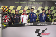 (L-R) Marc Marquez of Spain and Repsol Honda Team, Andrea Dovizioso of Italy and Ducati Team,  Valentino Rossi of Italy and Movistar Yamaha MotoGP, Jorge Lorenzo of Spain and Movistar Yamaha MotoGP and Pol Espargaro of Spain and Monster Yamaha Tech 3  pose during the MotoGp of France - Press Conference on May 14, 2015 in Paris, France.