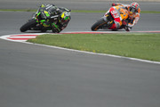 Pol Espargaro of Spain and Monster Yamaha Tech 3. leads Marc Marquez of Spain and Repsol Honda Team during the MotoGp Of Great Britain - Free Practice at Silverstone Circuit on August 29, 2014 in Northampton, United Kingdom.