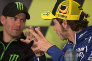 Valentino Rossi (R) of Italy and Yamaha Factory Racing speaks with Cal Crutchlow of Great Britain and Monster Yamaha Tech 3 during the press conference pre-event during the MotoGp Of France - Previews on May 16, 2013 in Le Mans, France.