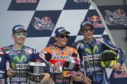 (L-R) Jorge Lorenzo of Spain and Movistar Yamaha MotoGP, Marc Marquez of Spain and Repsol Honda Team and Valentino Rossi of Italy and Movistar Yamaha MotoGP pose during the MotoGp Red Bull U.S. Grand Prix of The Americas - Qualifying at Circuit of The Americas on April 9, 2016 in Austin, Texas.