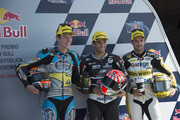 (L-R) Esteve Rabat of Spain and Estrella Galicia 0,0 Marc VDS, Johann Zarco of France and AJO Motorsport and Thomas Luthi of of Switzerland and Derendinger Racing Interwetten celebrate. at the end of the qualifying practice during the MotoGp of Argentina - Qualifying  at  on April 18, 2015 in Rio Hondo, Argentina.