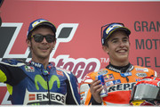 Marc Marquez of Spain and Repsol Honda Team and Valentino Rossi of Italy and Movistar Yamaha MotoGP (L) celebrate on the podium at the end of  the MotoGP Race during the MotoGp of Argentina - Race at Termas De Rio Hondo Circuit on April 03, 2016 in Rio Hondo, Argentina.