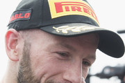 Tom Sykes of Great Britain and KAWASAKI RACING TEAM WorldSBK speaks with journalists and celebrates the third place under the podium at the end of the Superbike Race 1 during the Motul FIM Superbike World Championship - Race One at Donington Park on May 26, 2018 in Castle Donington, England.