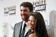 Olympic swimmer Michael Phelps (L) and model Nicole Johnson attend Muhammad Ali's Celebrity Fight Night XXIII at the JW Marriott Desert Ridge Resort & Spa on March 18, 2017 in Phoenix, Arizona.