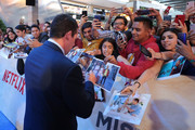 Adam Sandler signs autographs on the red carpet before 'Murder Mystery' premiere at Antara Polanco Fashion Hall on June 12, 2019 in Mexico City, Mexico.
