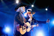 Willie Nelson (L) and Brandi Carlile perform onstage during MusiCares Person of the Year honoring Dolly Parton at Los Angeles Convention Center on February 8, 2019 in Los Angeles, California.