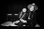Image has been converted to black and white.) Willie Nelson (L) and Brandi Carlile attend MusiCares Person of the Year honoring Dolly Parton at Los Angeles Convention Center on February 08, 2019 in Los Angeles, California.