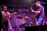 The Kings of Leon perform onstage at the Music City Food + Wine Festival Harvest Night Presented By Infiniti on September 20, 2014 in Nashville, Tennessee.