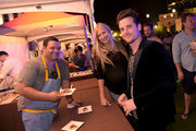 Michael Hudman, Holly Williams, and Jared Followill attend the Music City Food + Wine Festival Harvest Night Presented By Infiniti on September 20, 2014 in Nashville, Tennessee.