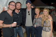 Jared Followill, Caleb Followill, Garrett Hedlund, Hayden Panettiere, and Clare Bowen attend the Music City Food + Wine Festival Harvest Night Presented By Infiniti on September 20, 2014 in Nashville, Tennessee.