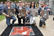 (L-R) Matthew Followill, Jared Followill, Nathan Followill and Caleb Followill of the band Kings of Leon pose with their Music City Ambassador Awards and Rolling Stones contributing writer Austin Scaggs (C)  at the Music City Walk Of Fame Induction Ceremony Honoring Kings Of Leon at Walk of Fame Park on September 21, 2012 in Nashville, Tennessee.