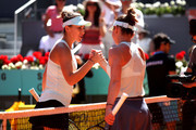 Belinda Bencic of Switzerland shakes hands with opponent Simona Halep of Romania after their ladies singles semi-final match during day seven of the Mutua Madrid Open at La Caja Magica on May 10, 2019 in Madrid, Spain.