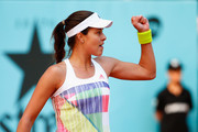 Ana Ivanovic of Serbia celebrates winning a point against Katerina Siniakova of Czech Republic during day two of the Mutua Madrid Open tennis tournament at the Caja Magica on May 01, 2016 in Madrid, Spain.