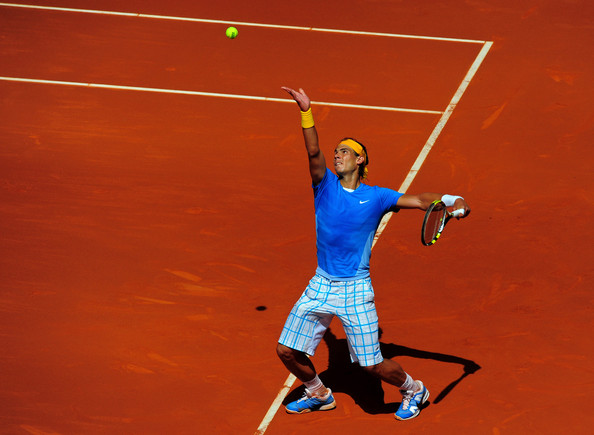 Rafael Nadal of Spain serves the ball to his fellow countryman Nicolas Almagro in their semi-final match during the Mutua Madrilena Madrid Open tennis tournament at the Caja Magica on May 15, 2010 in Madrid, Spain.