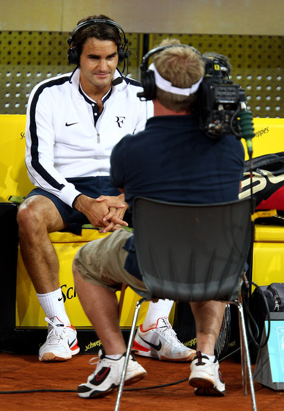 Roger Federer of Switzerland is interviewed for television after his straight sets victory against Stanislas Wawrinka of Switzerland in their third round match during the Mutua Madrilena Madrid Open tennis tournament at the Caja Magica on May 13, 2010 in Madrid, Spain.